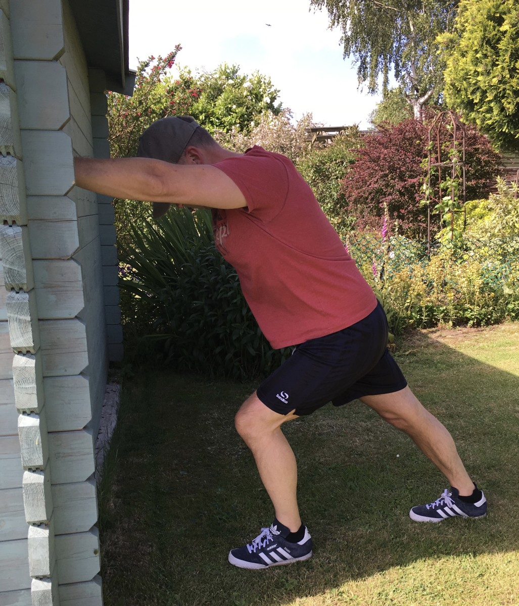 Use a wall to hold a deep stretch to the calf.