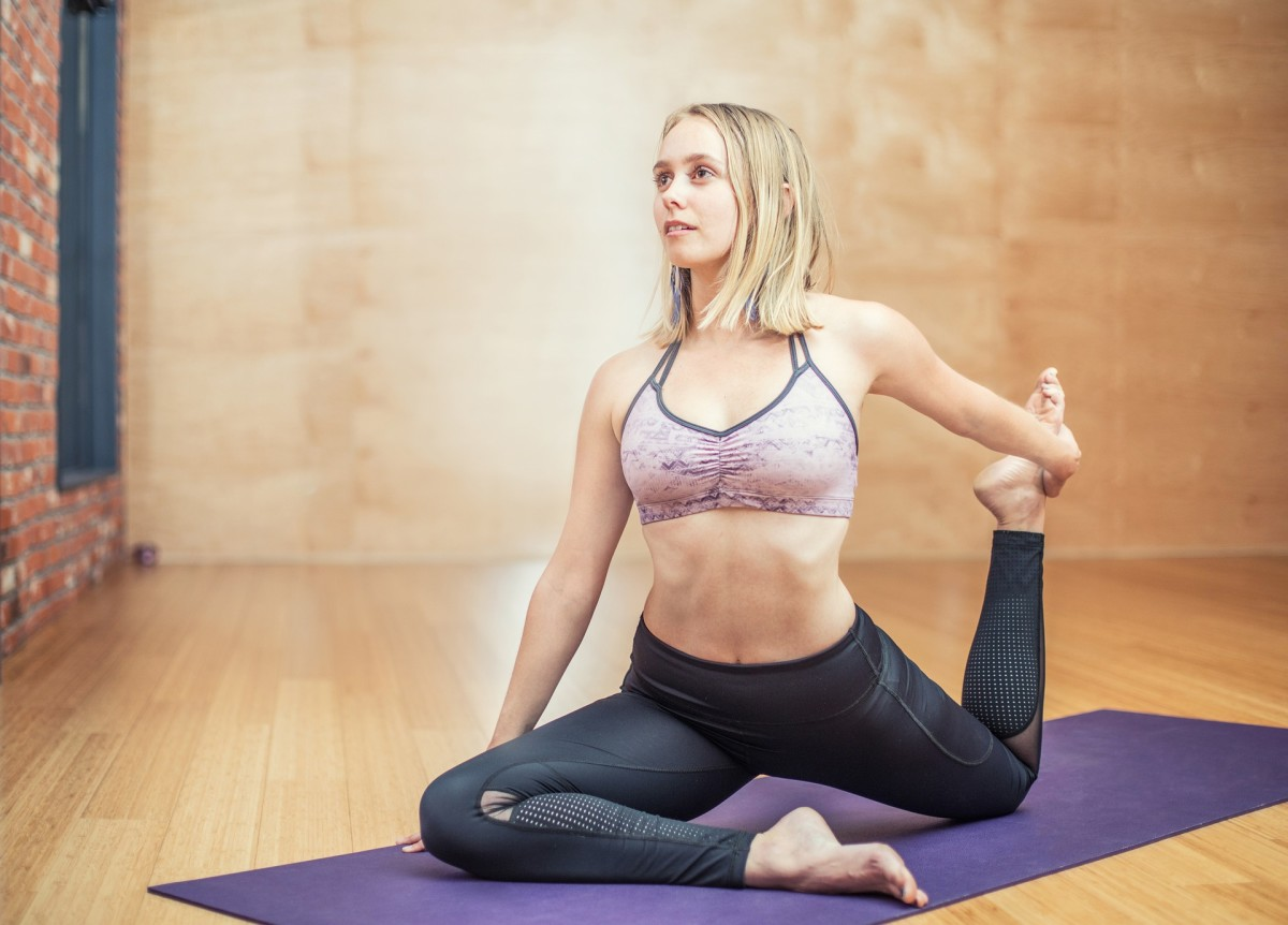 Yoga has many health benefits, one being that it helps relieve back pain.
