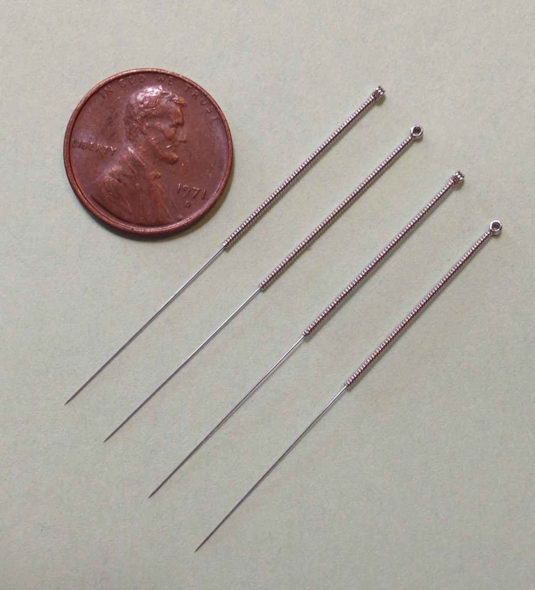 Acupuncture is a traditional Chinese medicinal technique that involves inserting small needles, shown above, into different points on the body.