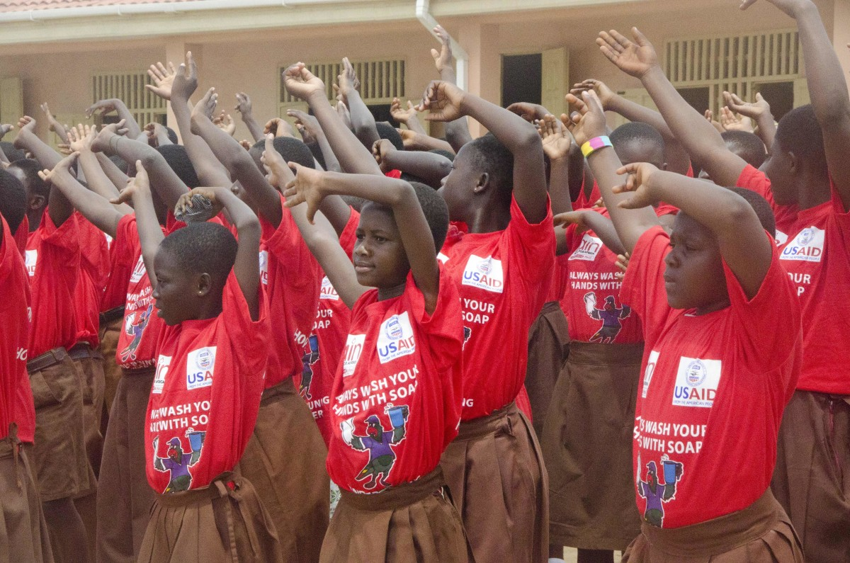 Children celebrate Handwashing Day in Lekma South Cluster of Schools, where USAID has built school bathrooms and handwashing stations to prevent disease spread. (USAID/A. Kauffeld)