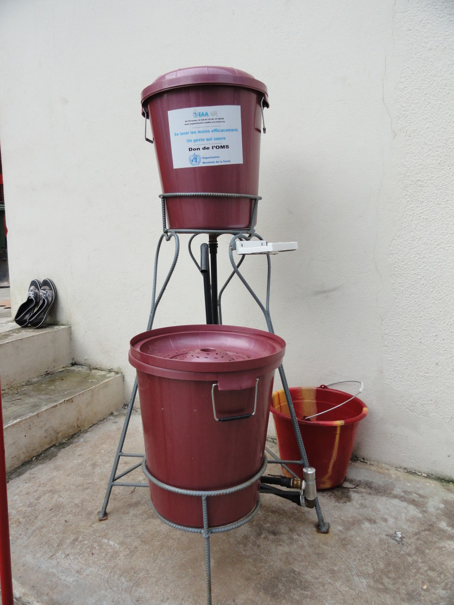 Handwashing station. These are filled with chlorinated water and can be found in various locations, such as entryways for hotel workers, WHO headquarters, and restaurants.  CDC Global / CC BY (https://creativecommons.org/licenses/by/2.0)