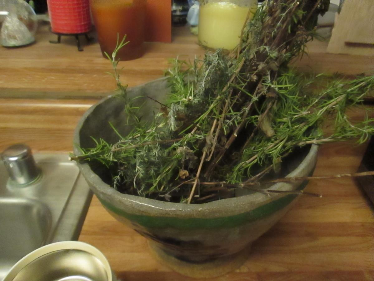 Rosemary and Greek oregano in a bowl I made.
