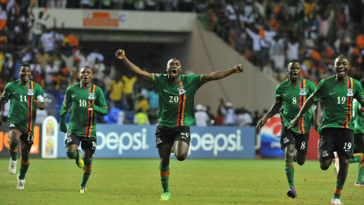 From left to right: Christopher Katongo, Felix Katongo, Emmanuel Mayuka, Isaac Chansa and Nathan Sinkala celebrate following Zambia's victory at the 2012 African Cup of Nations in Libreville, Gabon.