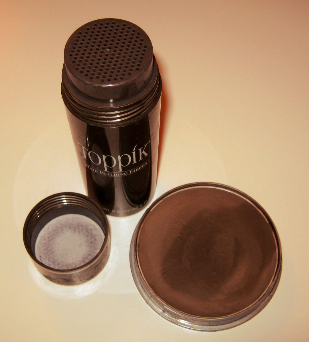 Hair building fibers in a shaker container (left) and water-activated hair loss concealer (right).