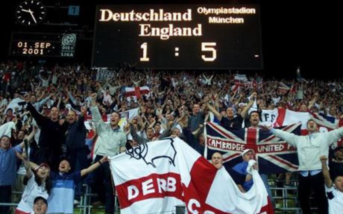 English fans celebrate in München, Germany as England plays Germany in a 2002 World Cup qualifier. The 5-1 victory for England helped the nation top Germany in its qualifying group.