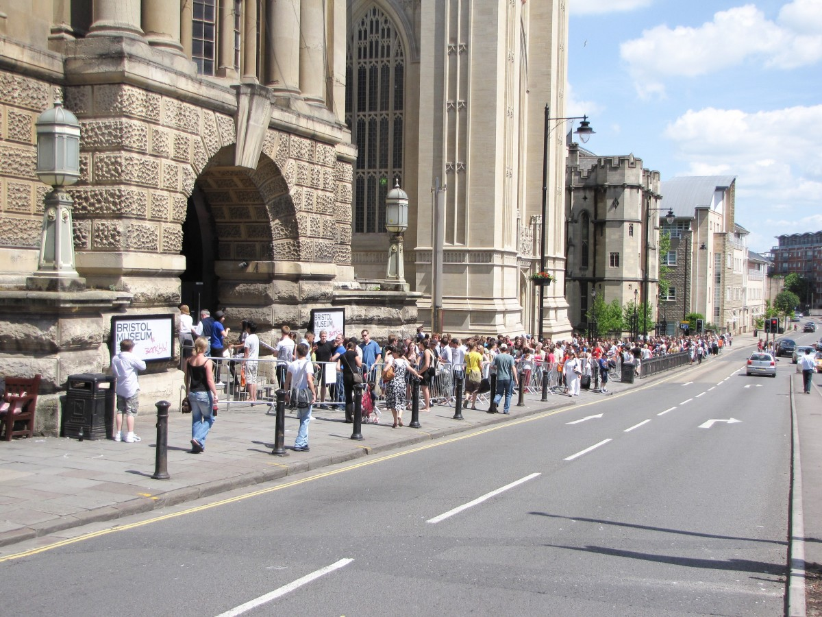 Lining up for a Banksy exhibition outside the Bristol Museum and Art Gallery