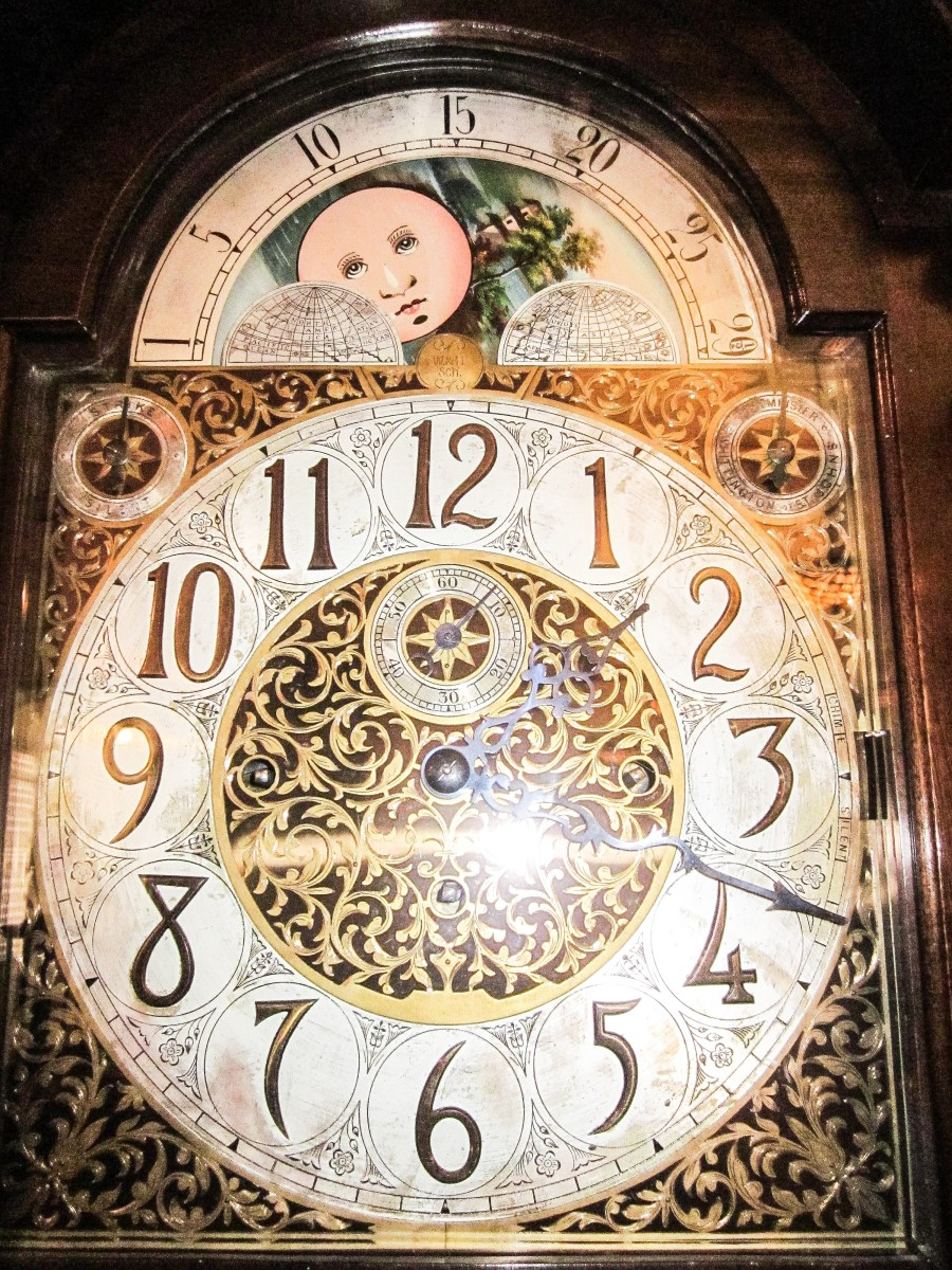 The hole leading to Pod, Homily, and Arrietty Clock's home is located under a grandfather clock.