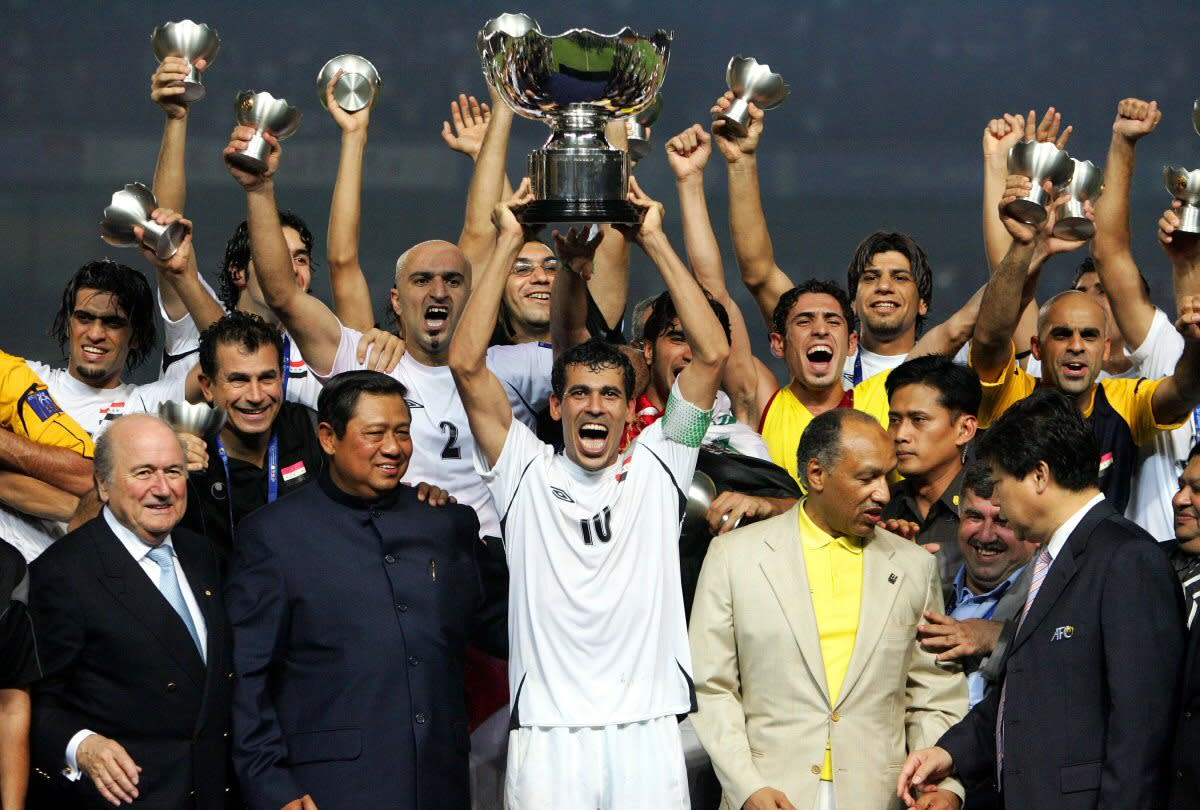 Iraq's Younis Mahmoud (10) hoists the trophy along with teammates and other dignitaries after Iraq won the 2007 Asian Cup in Jakarta, Indonesia