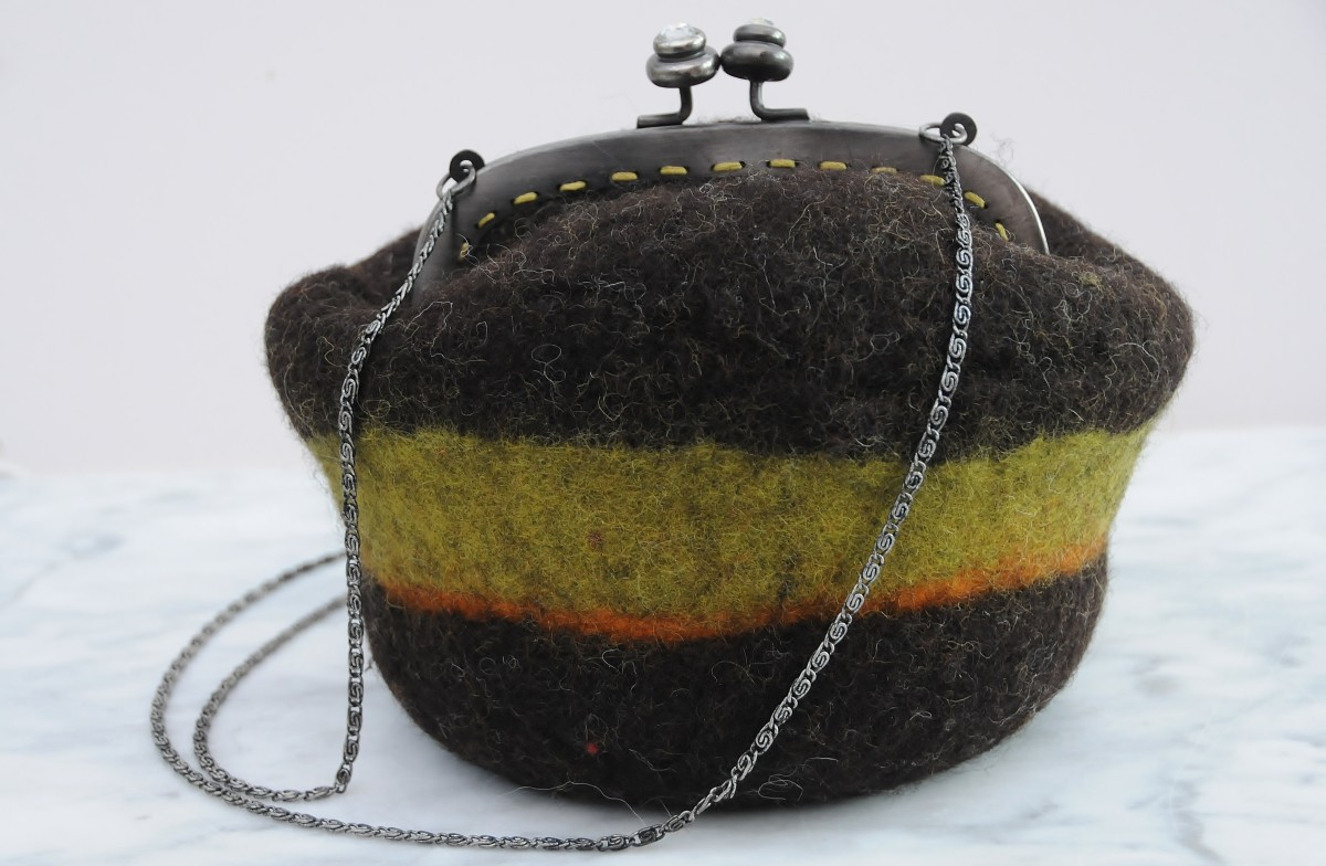 A wet felted shoulder purse and recycled purse frame made on a Gertie ball