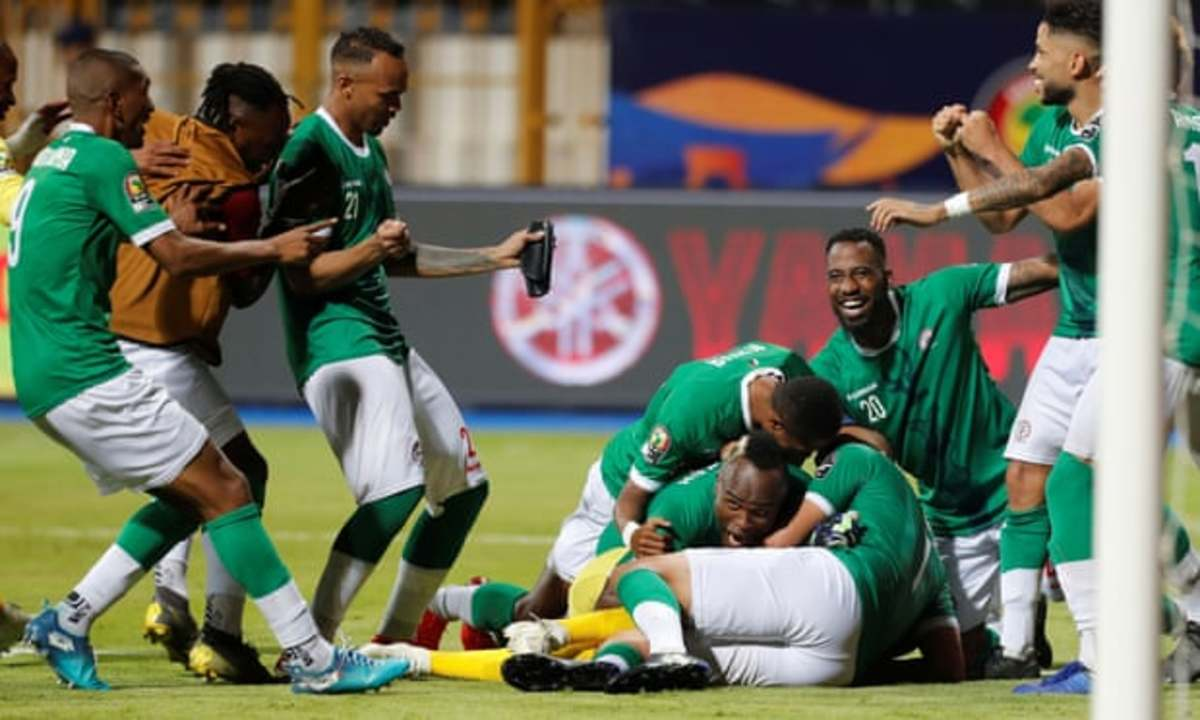 Madagascar's Thomas Fontaine (#21) and Romain Métanire (#20) celebrate following the conclusion of a 2019 Africa Cup of Nations Round of 16 match against DR Congo in Alexandria, Egypt. Madagascar reached the quarterfinals in its debut.