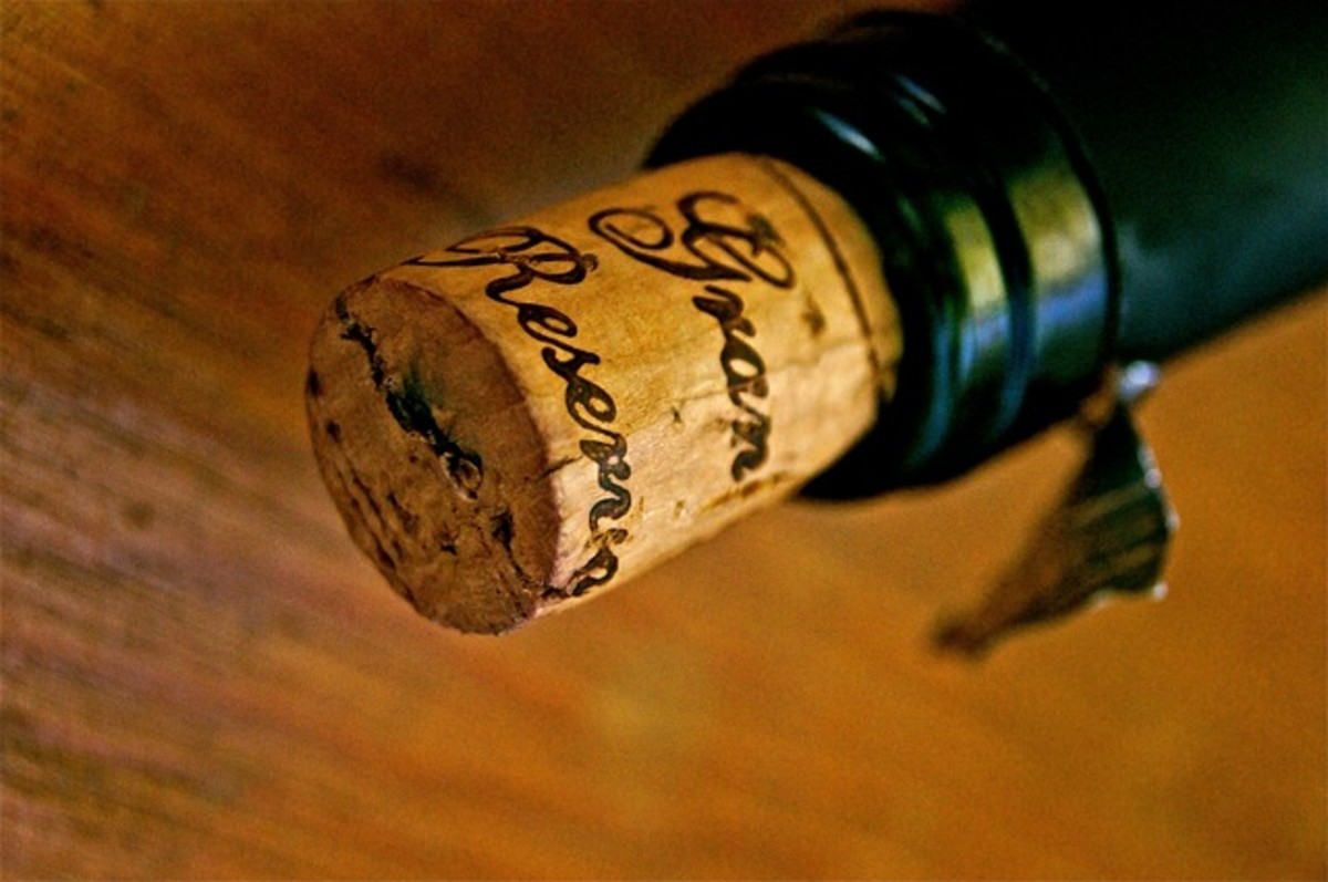A traditional cork jutting teasingly out of a wine bottle's neck.