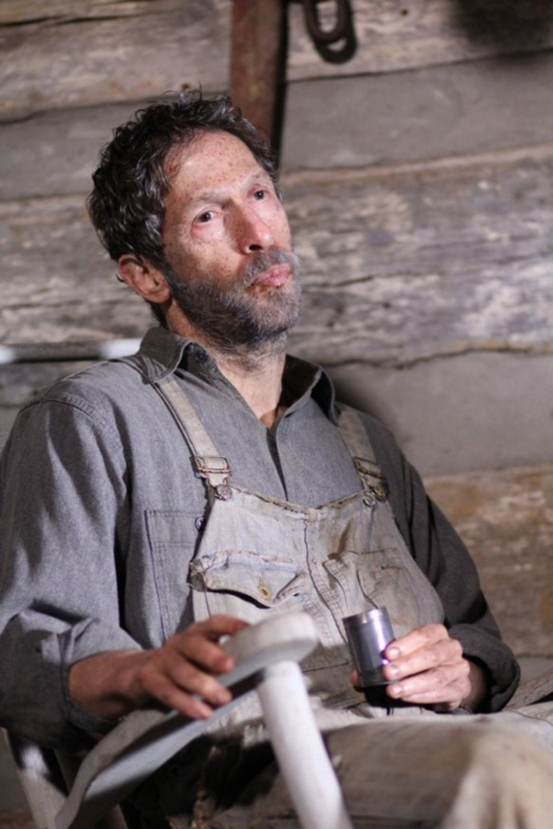 Tim Blake Nelson bears remarkably little resemblance to Tim Blake Nelson as Anse.