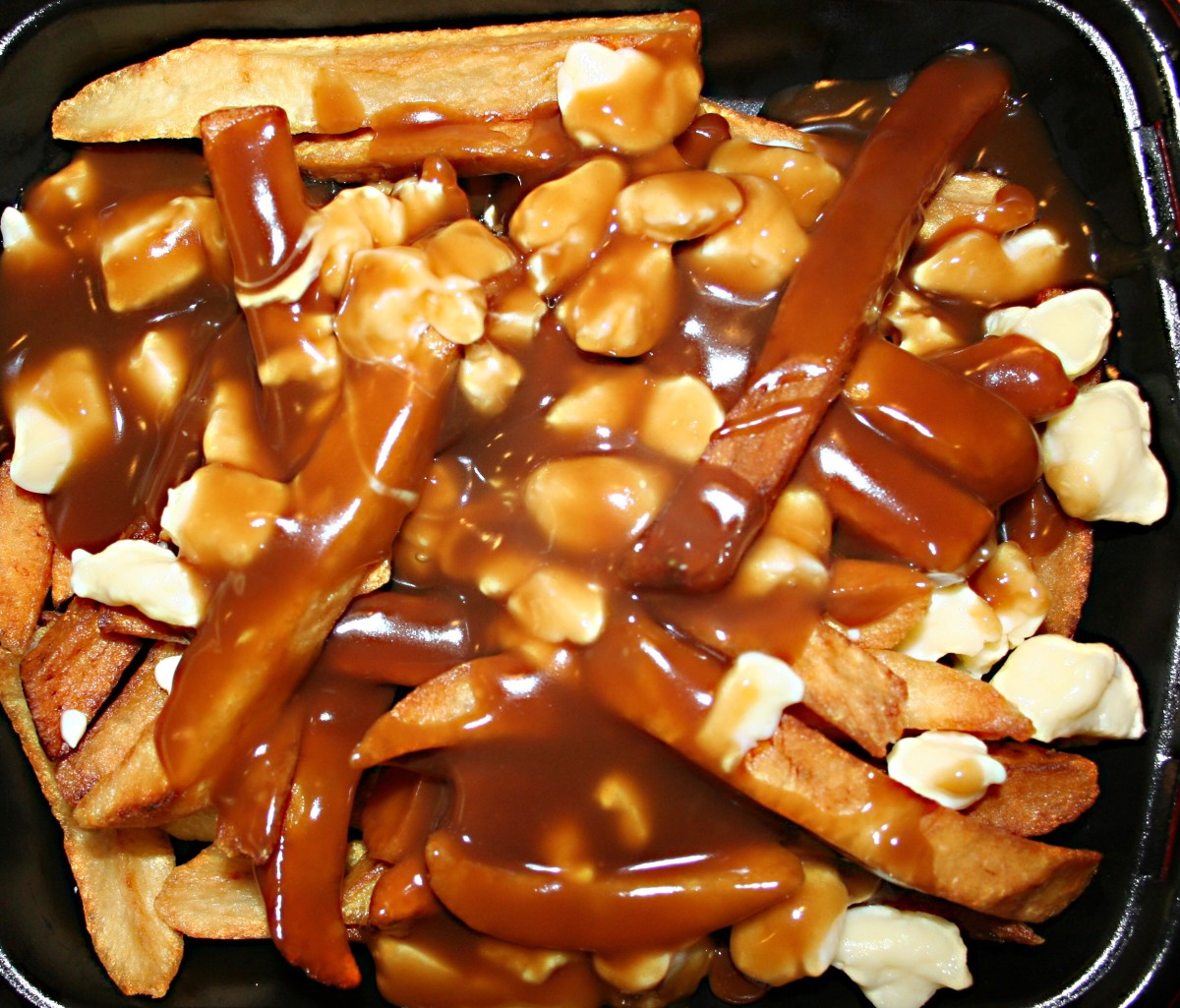 Poutine is a delicious mess made from French fries, cheese curds, and gravy.