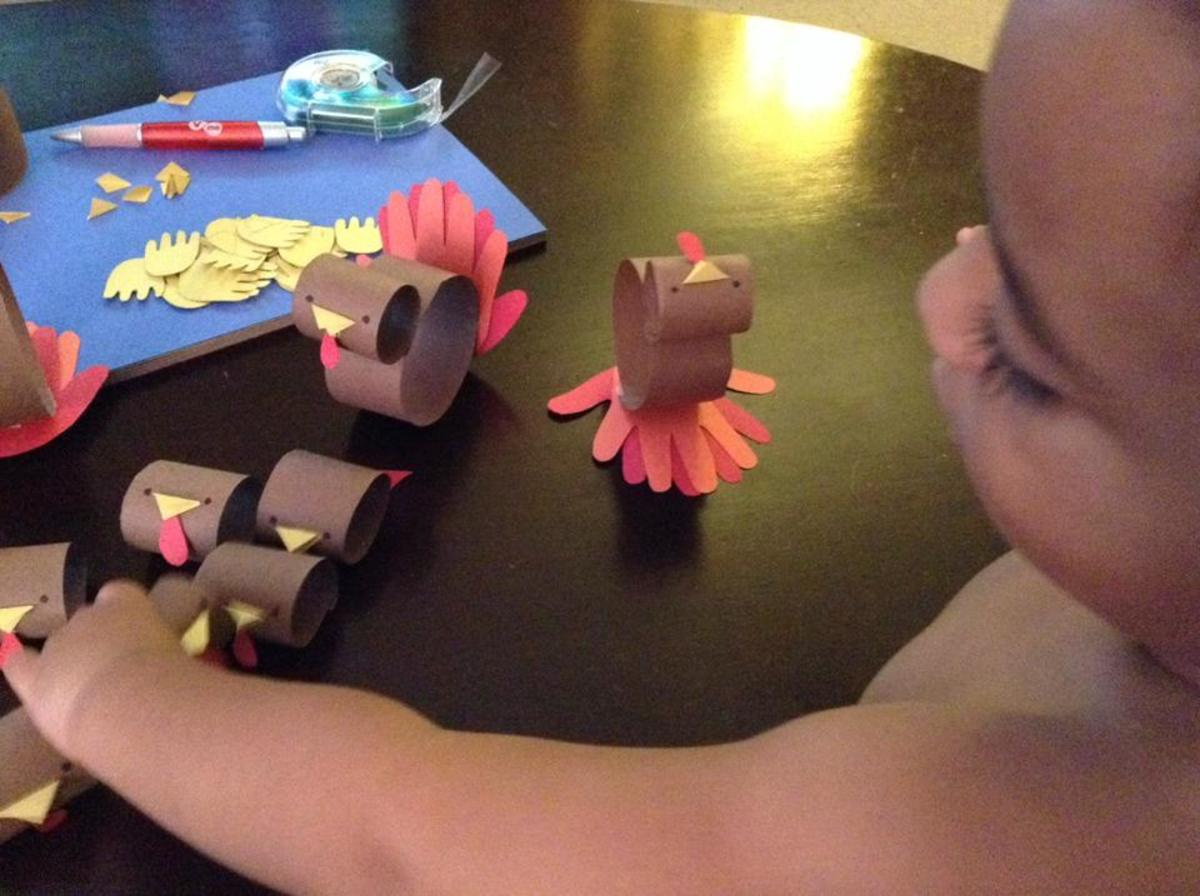 Julian assisting me in the assembly of our paper turkey army.