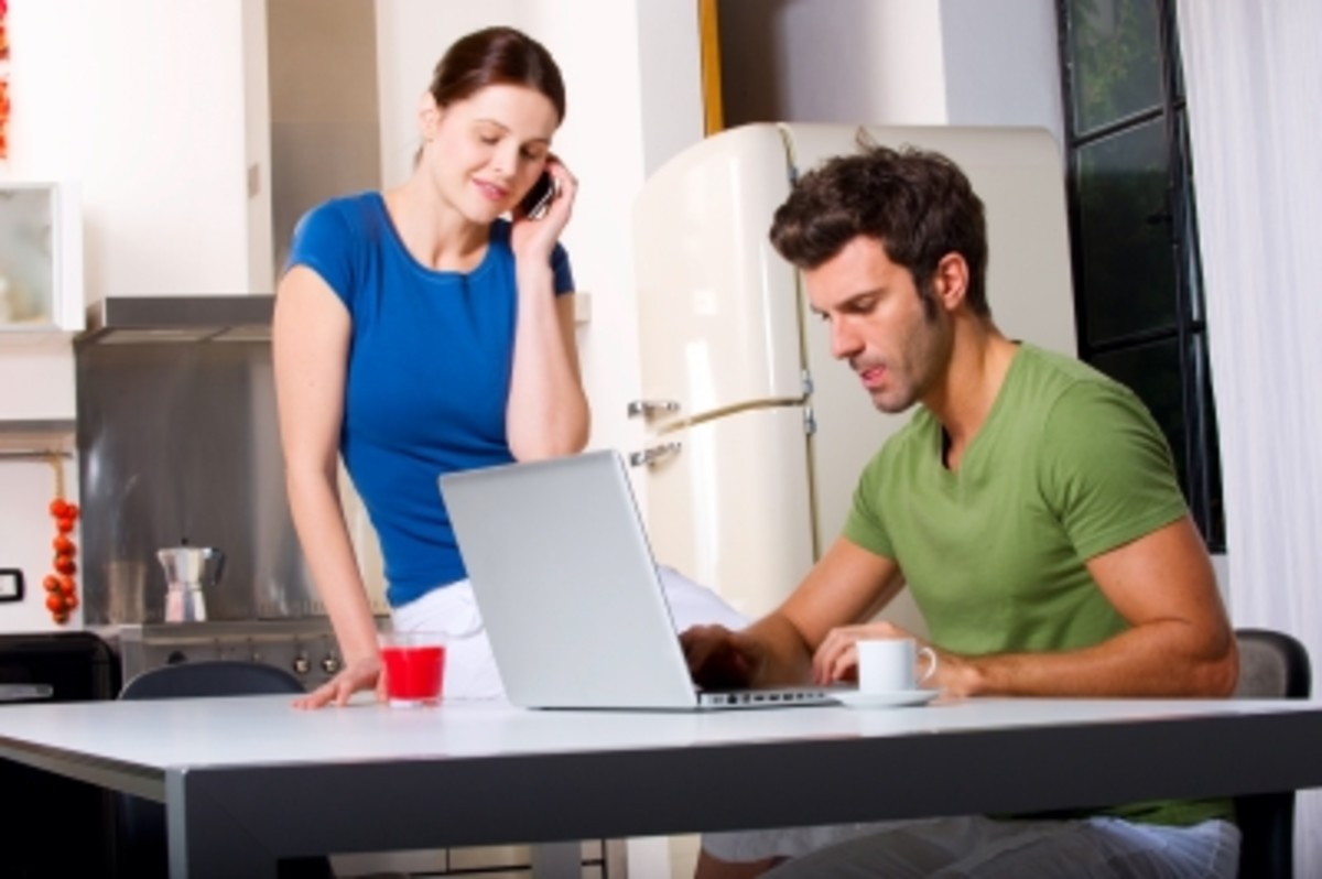 A couple on mobile phone and laptop