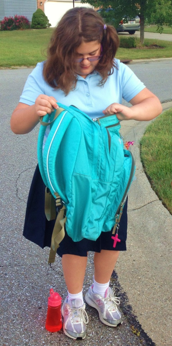 What's in my trusty backpack? Children pack their bags with school supplies and necessary personal items such as snacks, water, and clothing.