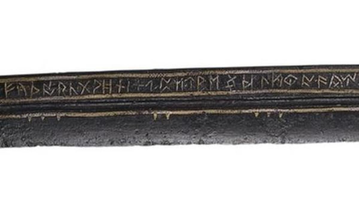 Detail of the blade, showing the full Anglo-Saxon Futhorc runic alphabet.