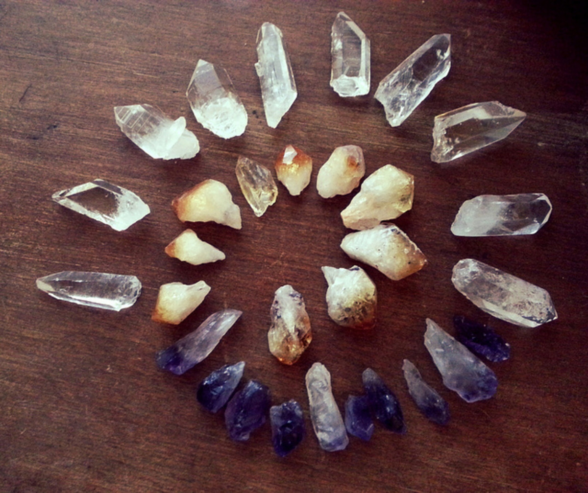 Raw, unpolished Clear quartz, Amethyst, and Citrine crystals.