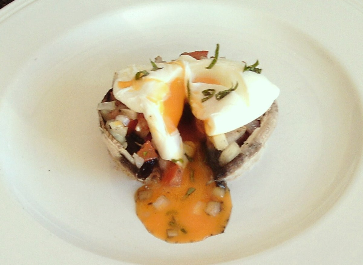 A breakfast themed tomato and onion stuffed portobello mushroom with poached egg is one of the recipes to be found on this page