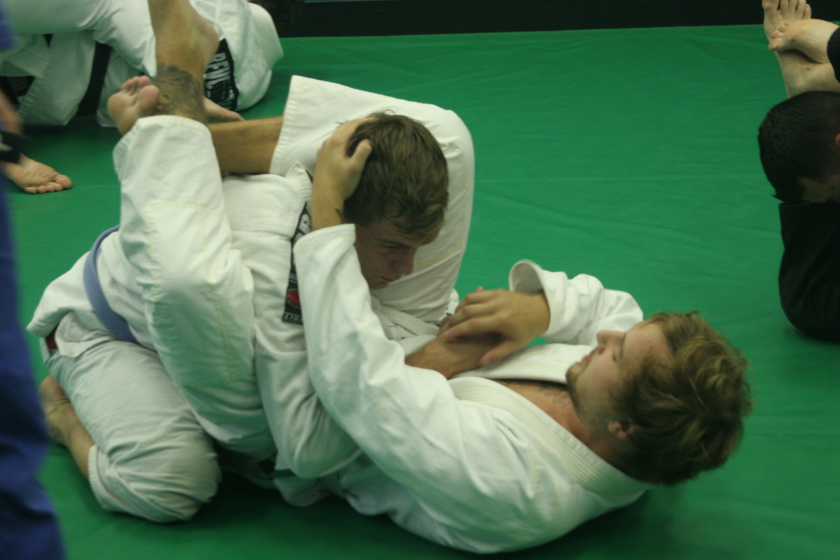 Triangle Maintenance - Dealing with the Hand in the Collar:  a BJJ Tutorial