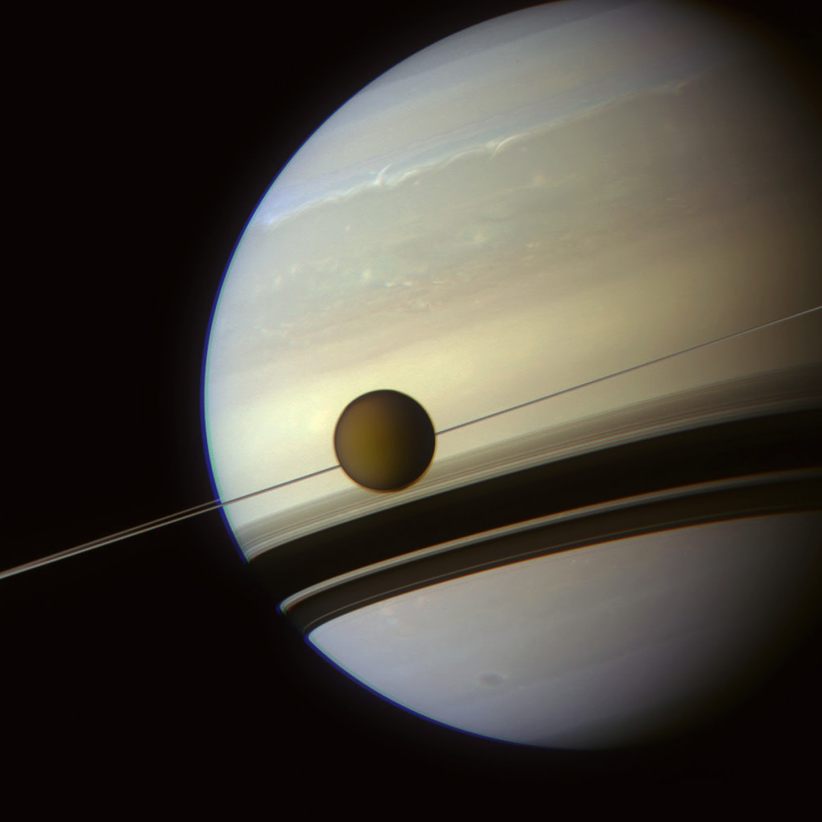 Titan lines up beautifully with Saturn's rings.