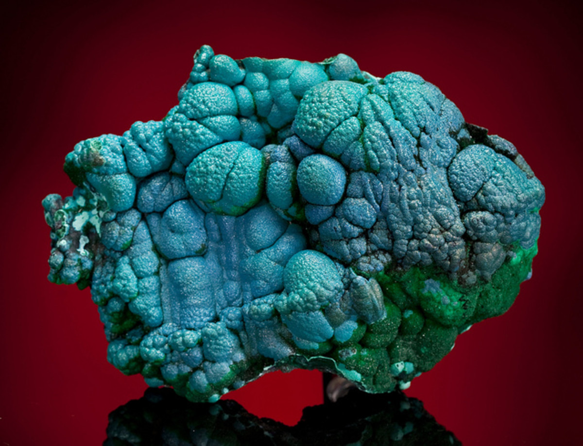 An unpolished chrysocolla stone. Use this stone to boost confidence and remove negative emotions.