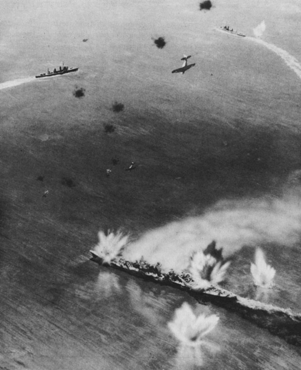 The USS North Carolina under attack from Japanese warplanes.