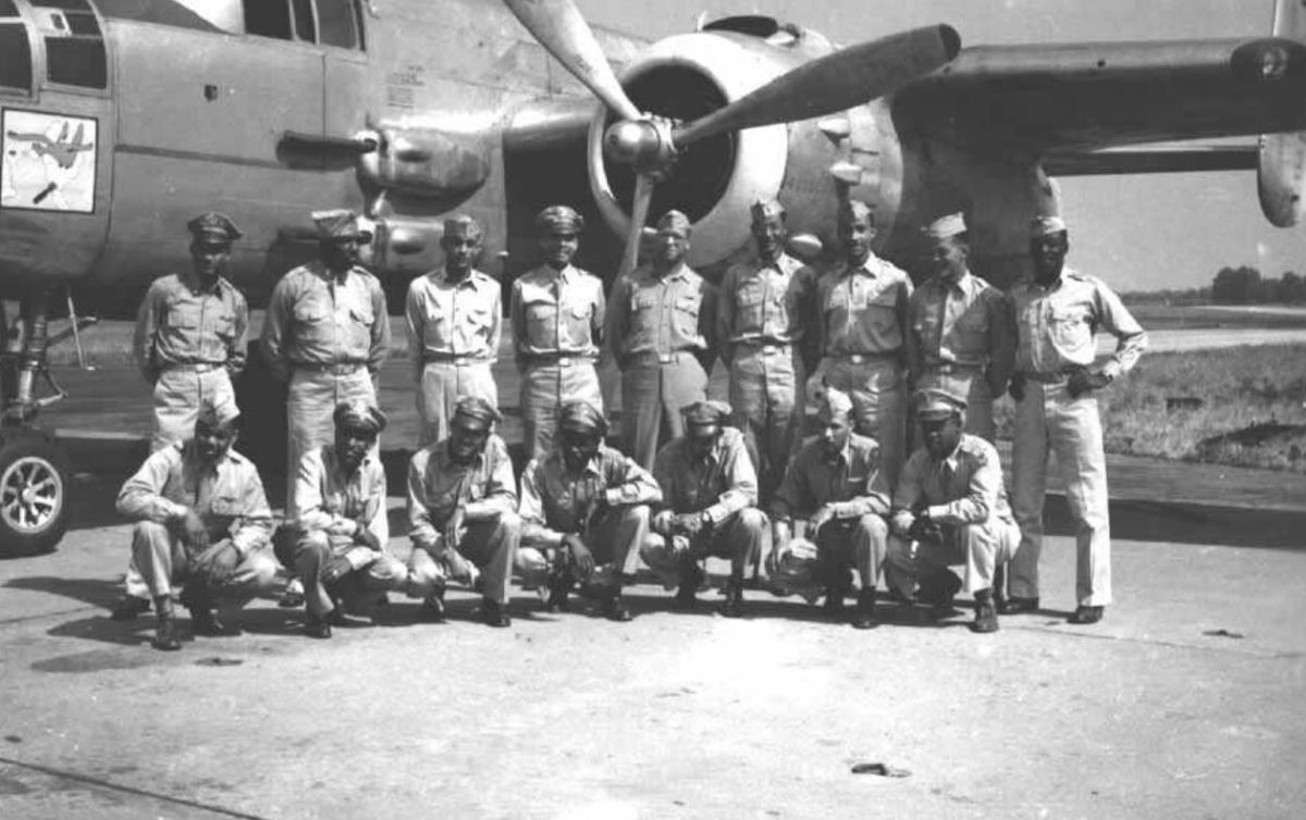 Pilots and ground officers of the 477th with one of their B-25 bombers