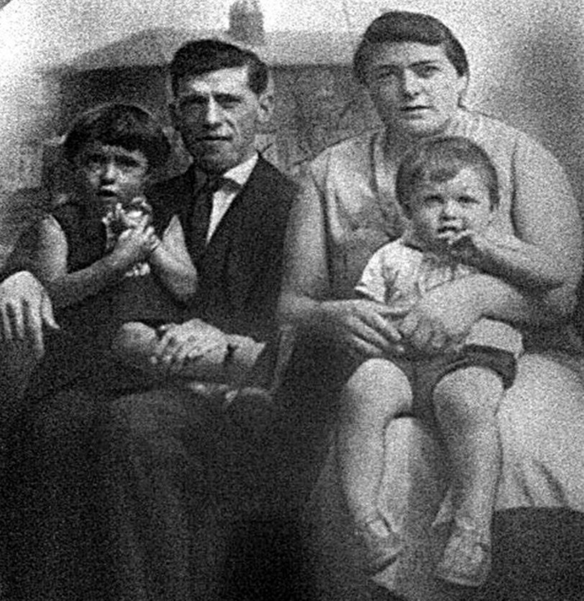 Grandad and grandma, with my mum (on grandad's knee) and her little brother Kenneth, in the early 1930s.