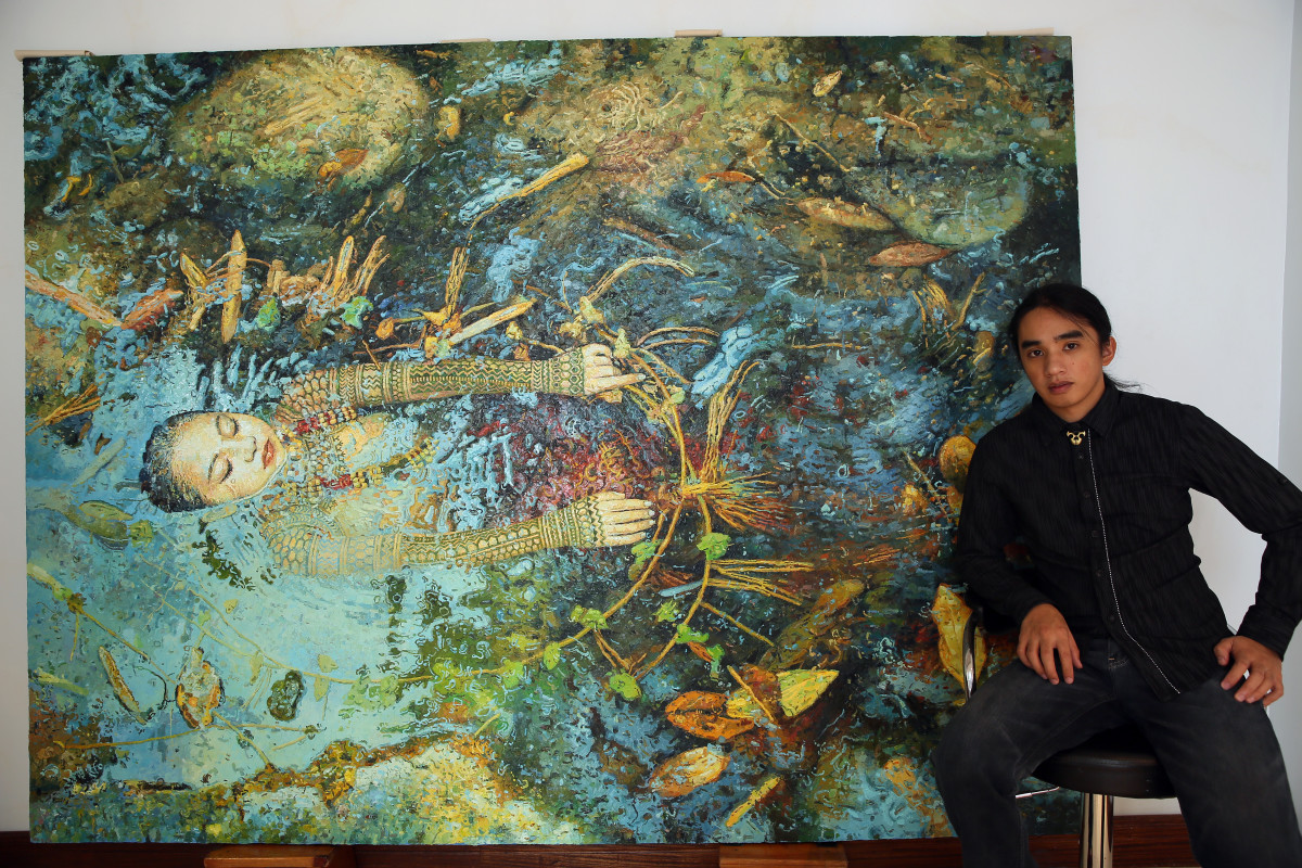 "Jef Cablog with his ""Downstream"" painting (72 x 96 inches)"