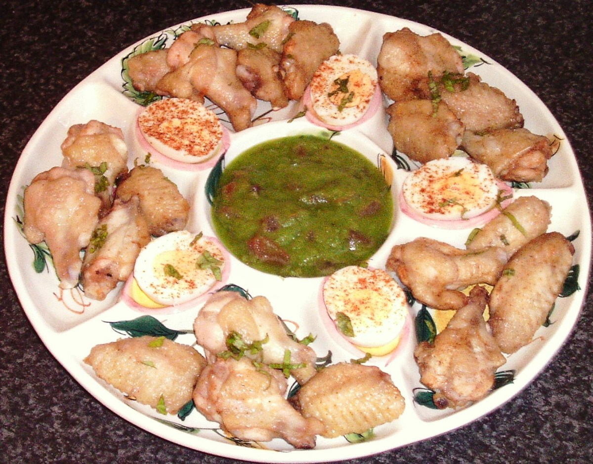 Zucchini guacamole and roast chicken wings platter.