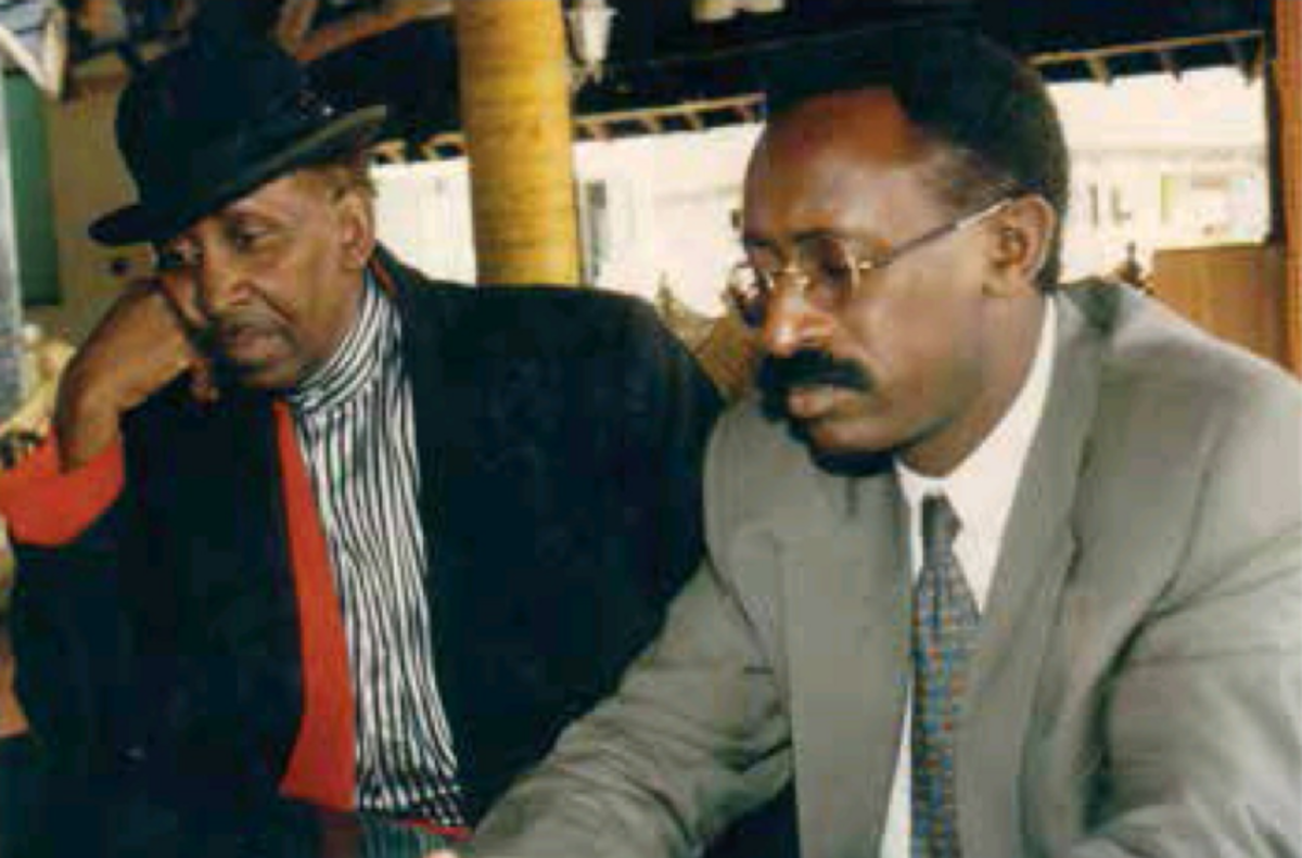 Fadhili William (left)