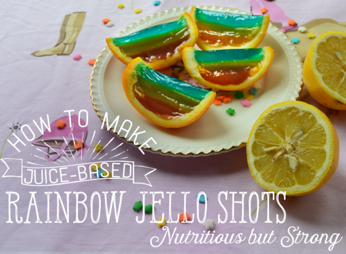 Rainbow juice-based jello shots in orange peels.