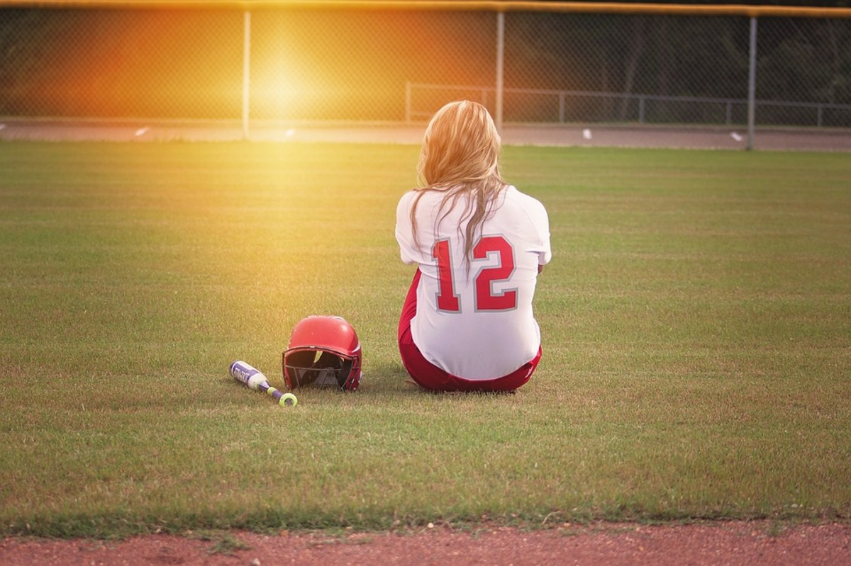Encourage an athlete by cheering her on at one of her games.