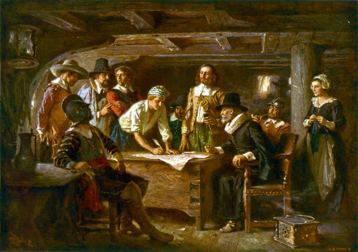 Below deck on the Mayflower: the signing of the Mayflower Compact, painted by Jean Leon Gerome Ferris in 1899