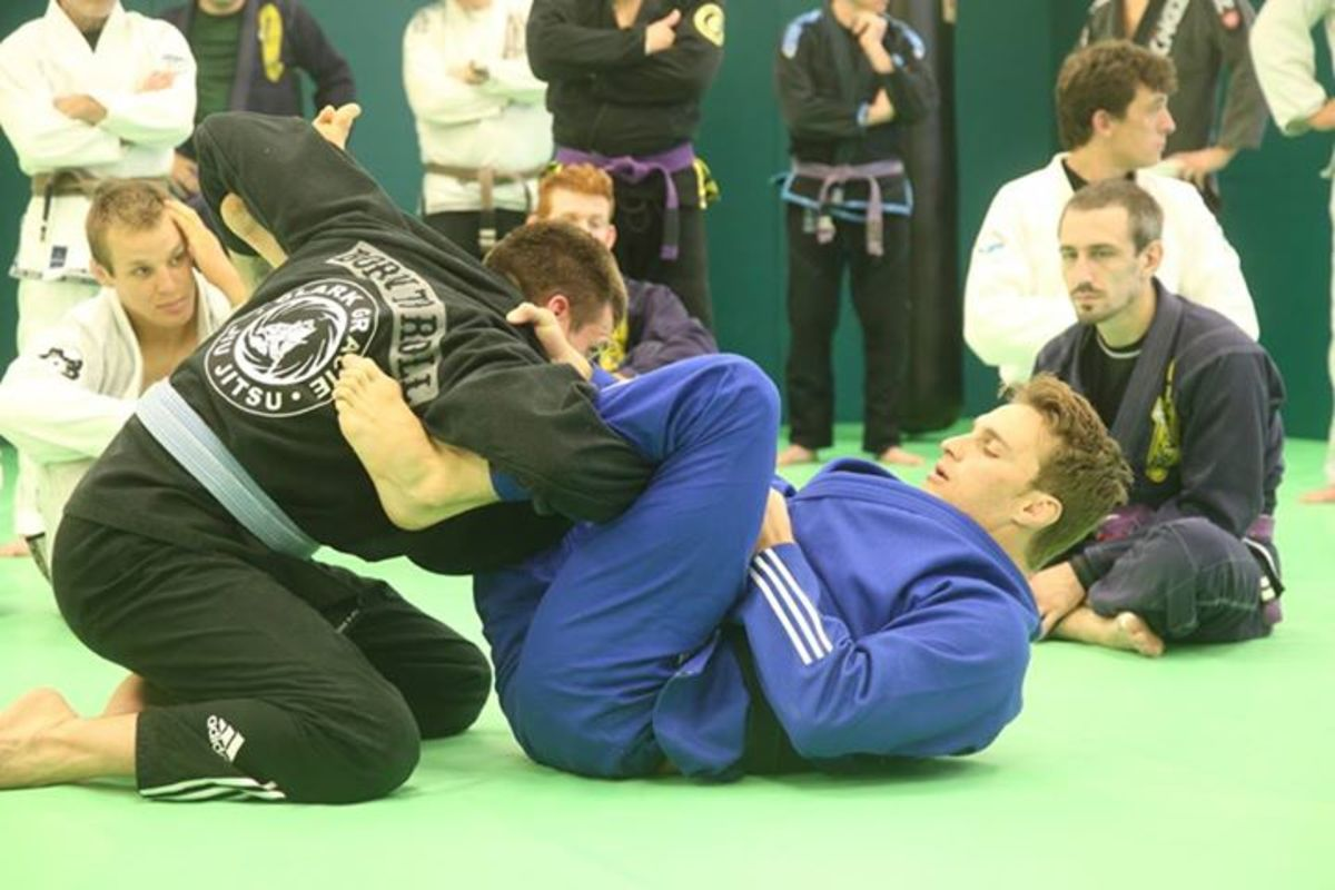 Deep lasso hooks demonstrated by Clark Gracie at Revolution BJJ