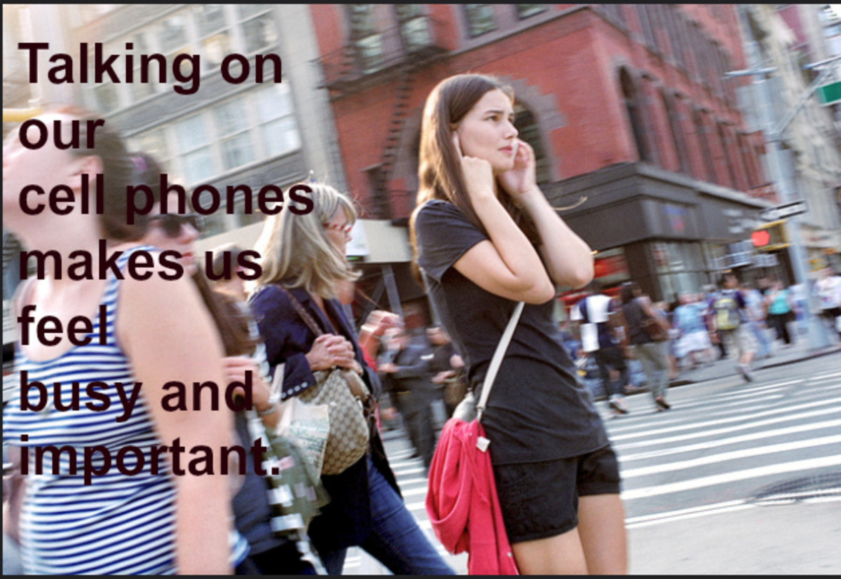 Cell phones are the must-have accessory for those who need to appear busy.