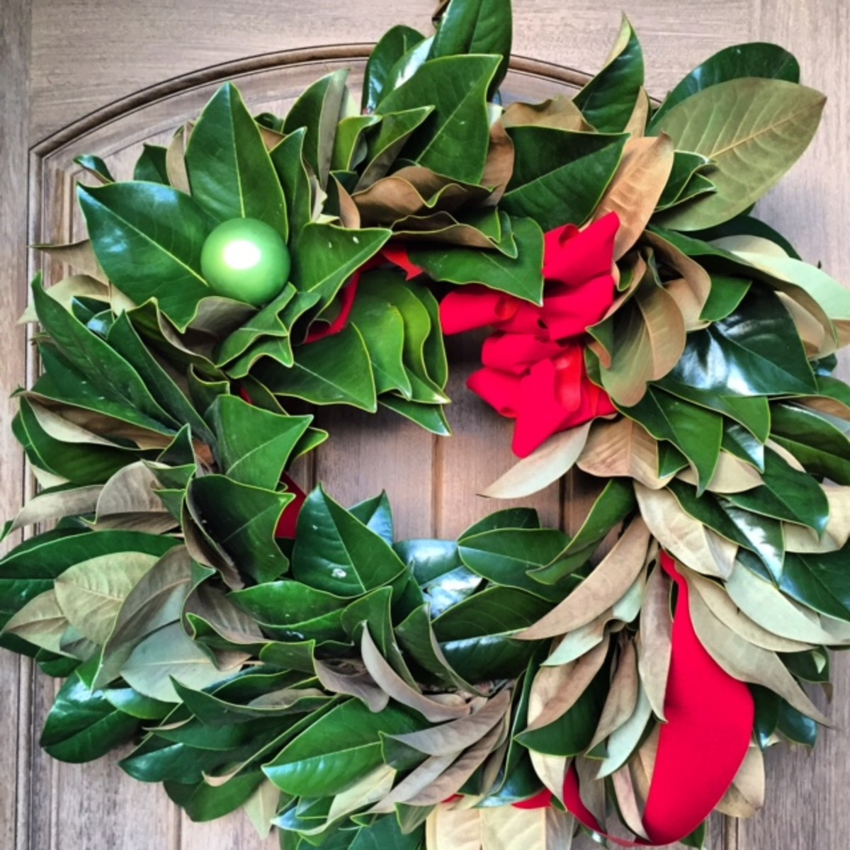 A fresh magnolia wreath makes a festive statement.