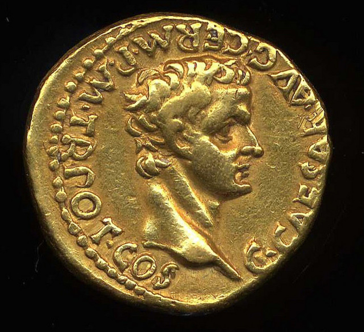 A golden coin depicting Caligula