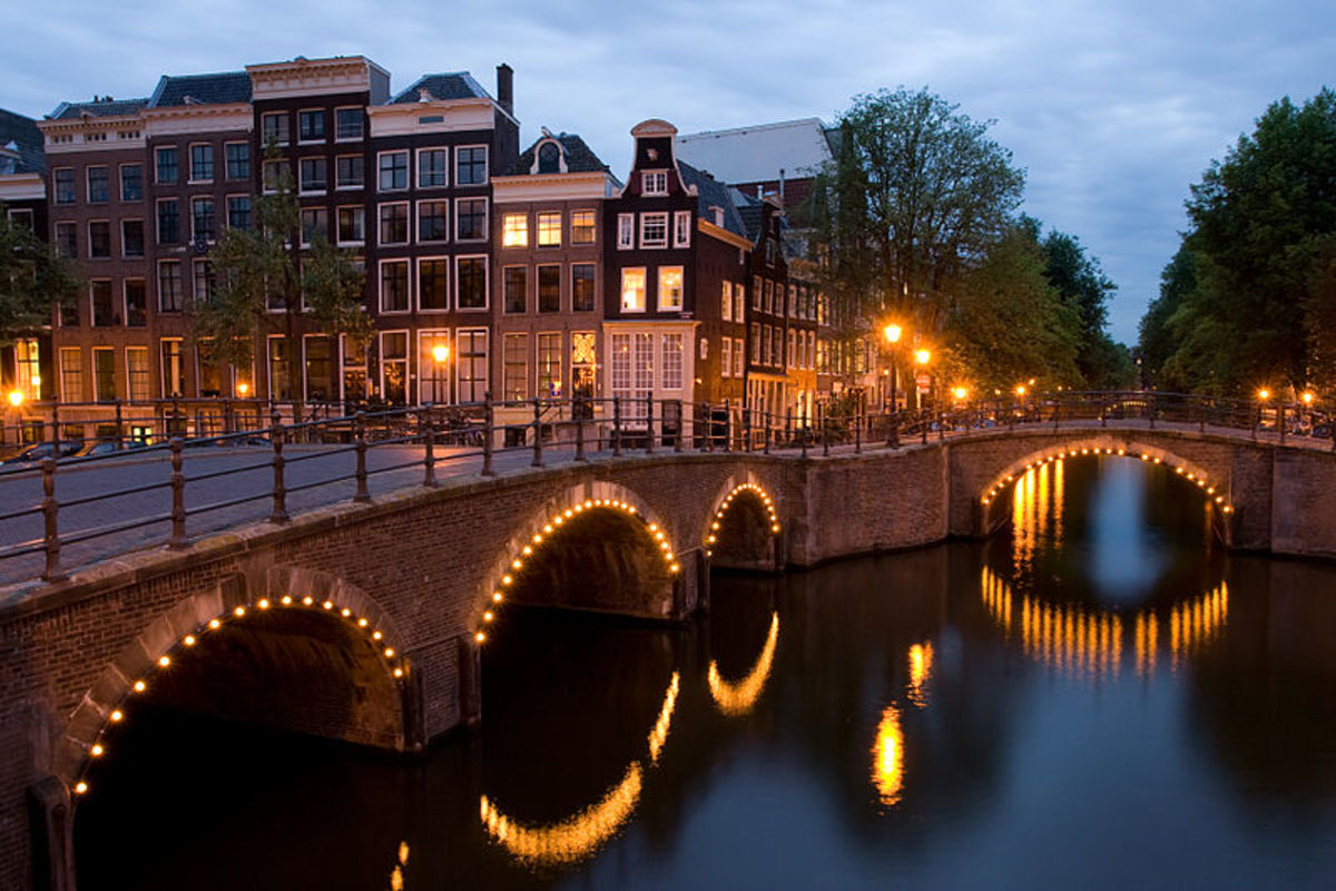 Canal houses at night in Amsterdam.