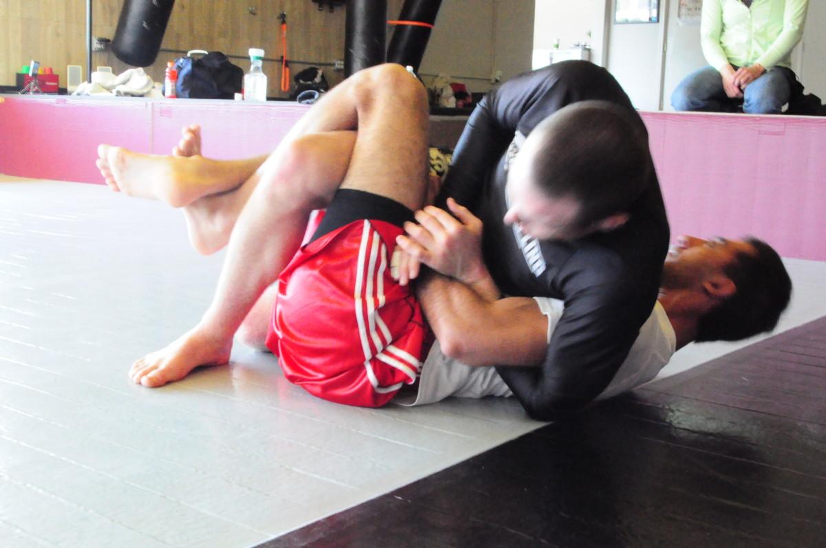 Using the Kimura grip.