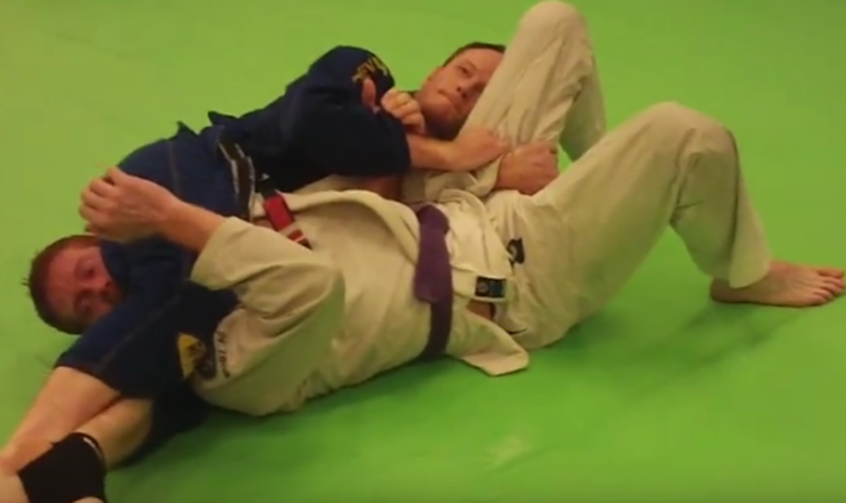 Learn how to do a head scissors in BJJ.