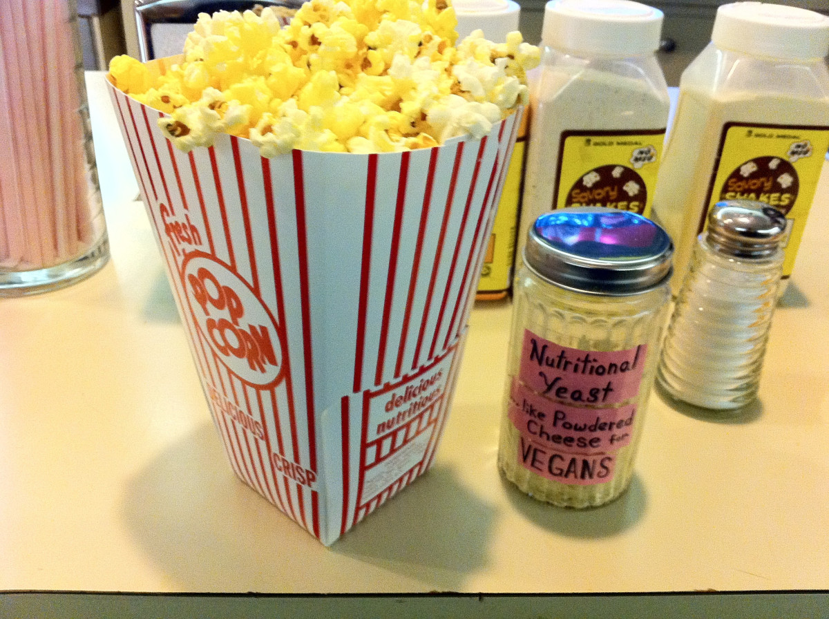 "Say, ""no"" to the greasy oil and over-salted theater popcorn.  Instead, opt for a sprinkle of cheesy tasting nutritional yeast with a little sea salt."