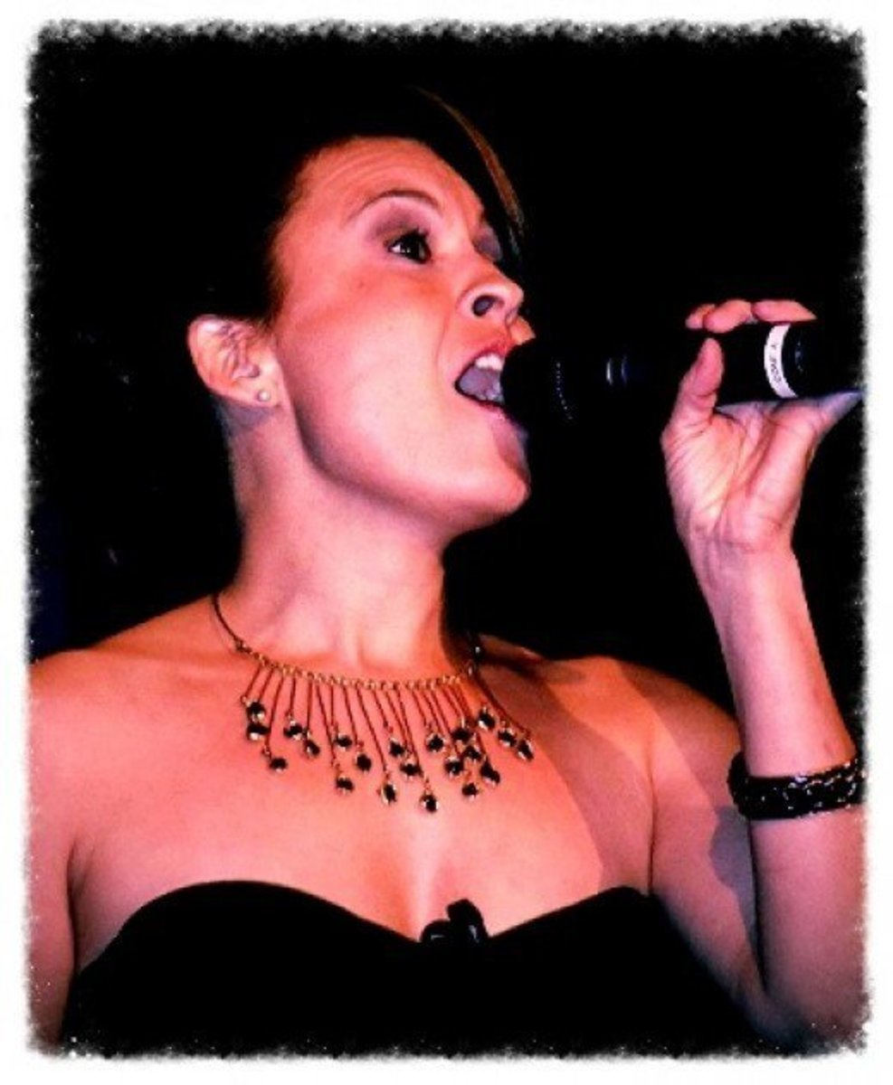 Angela Hernandez, authors former student, and professional singer
