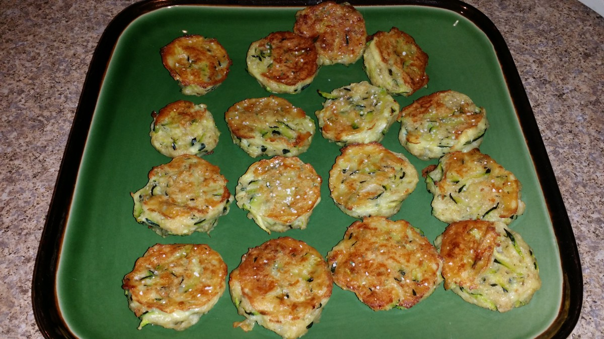 Zucchini dots are made from grated zucchini, egg, bread crumbs, and cheese.