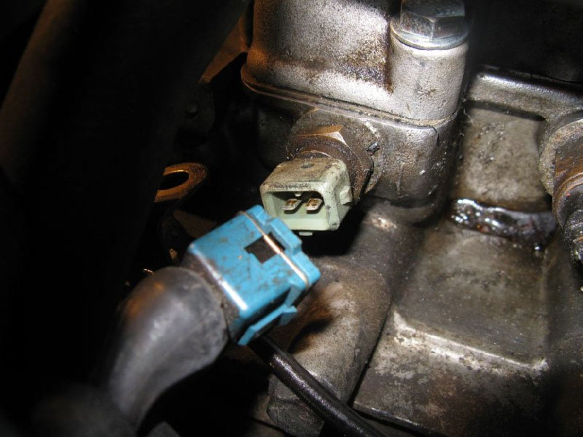 most coolant temperature sensors resemble a large nut with an electrical  connector on top