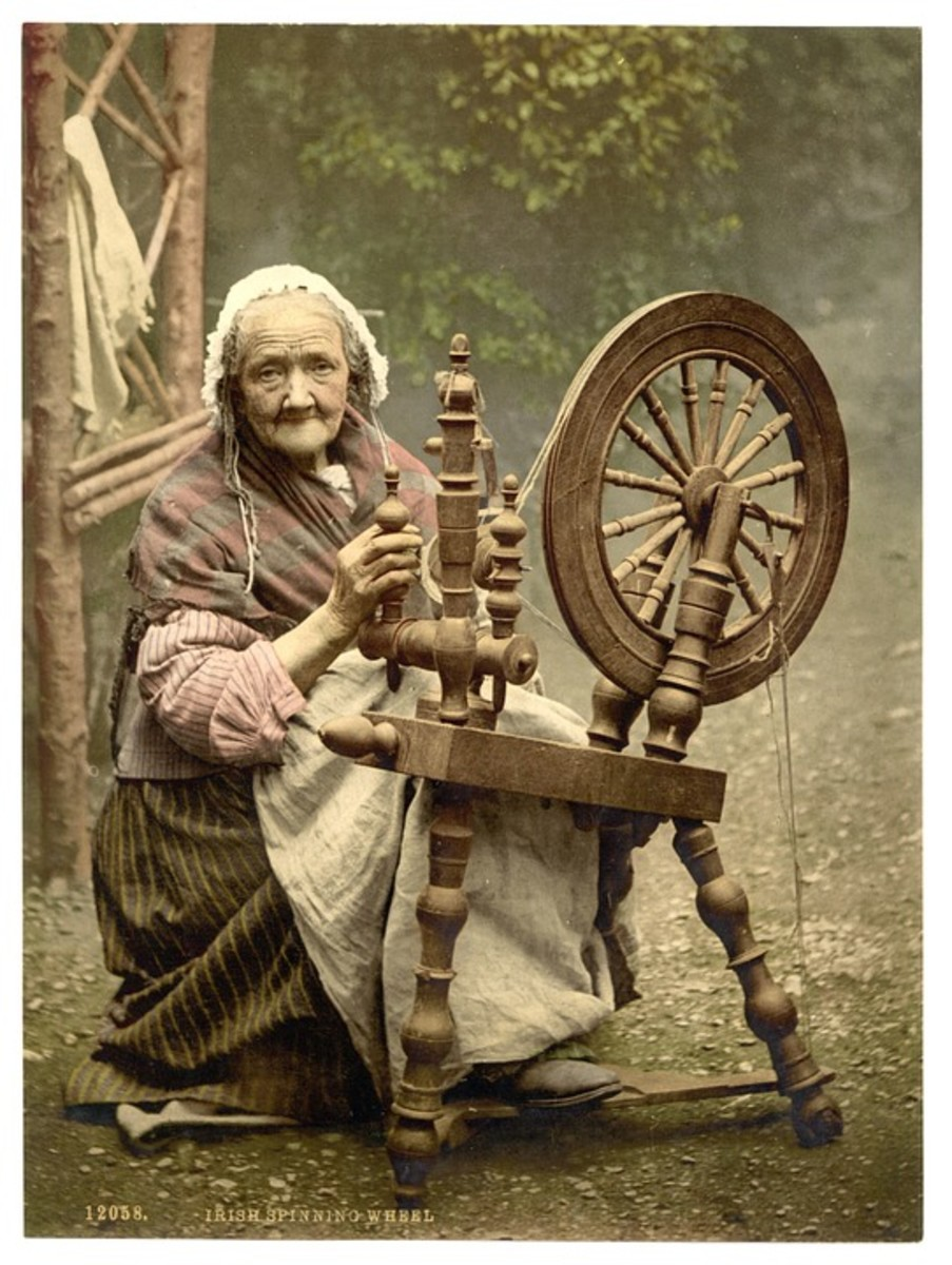 Irish woman at her spinning wheel, c. 1900