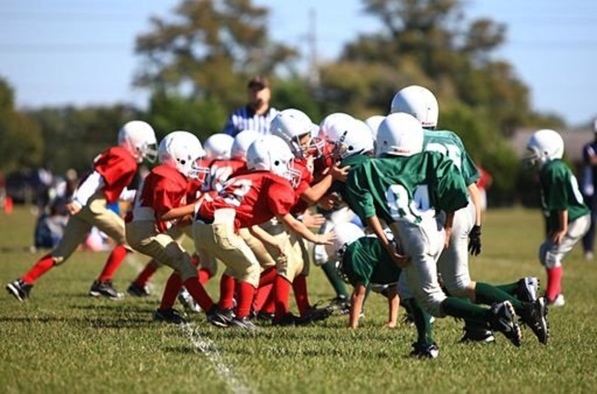 Youth football players playing a game at Camp Lejeune, North Carolina.