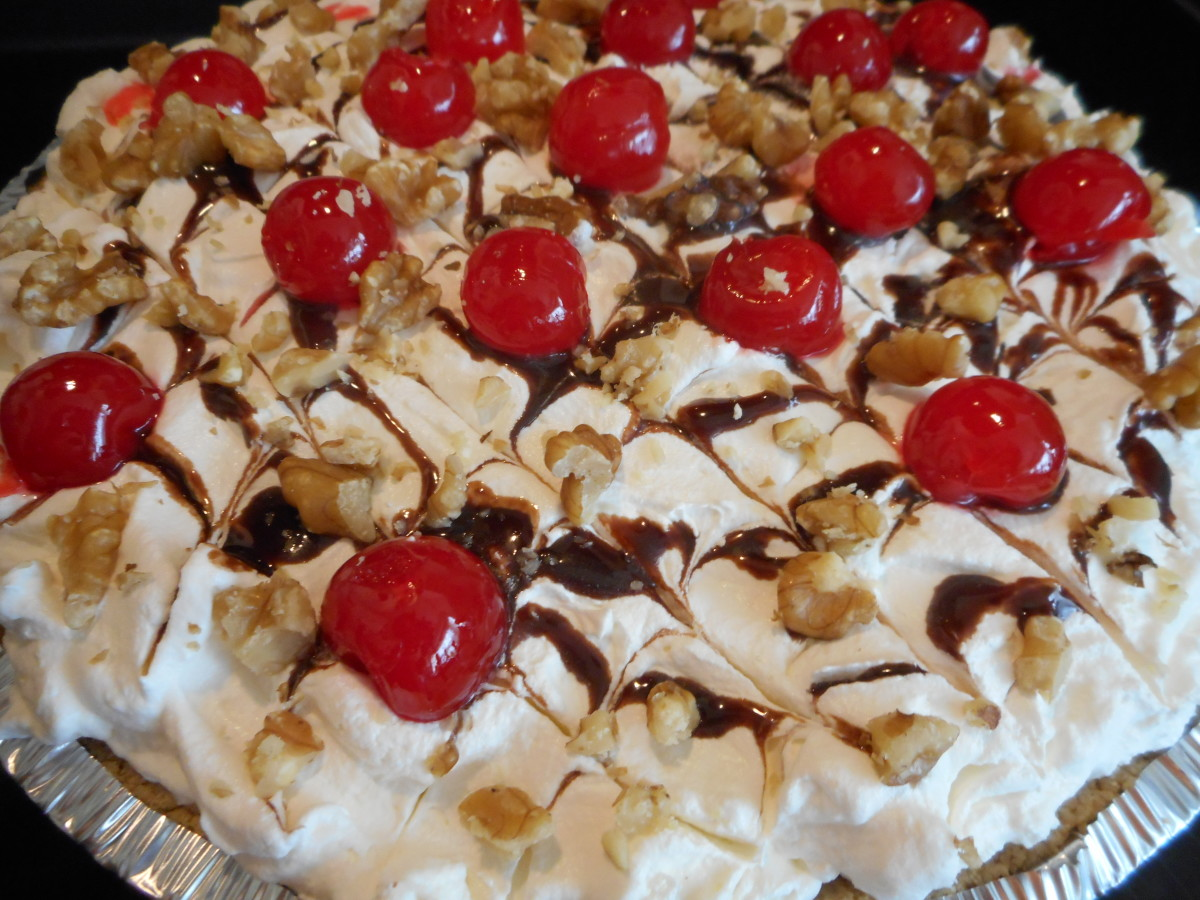 Banana-Split Dessert Topped With Cherries, Walnuts and Chocolate Syrup