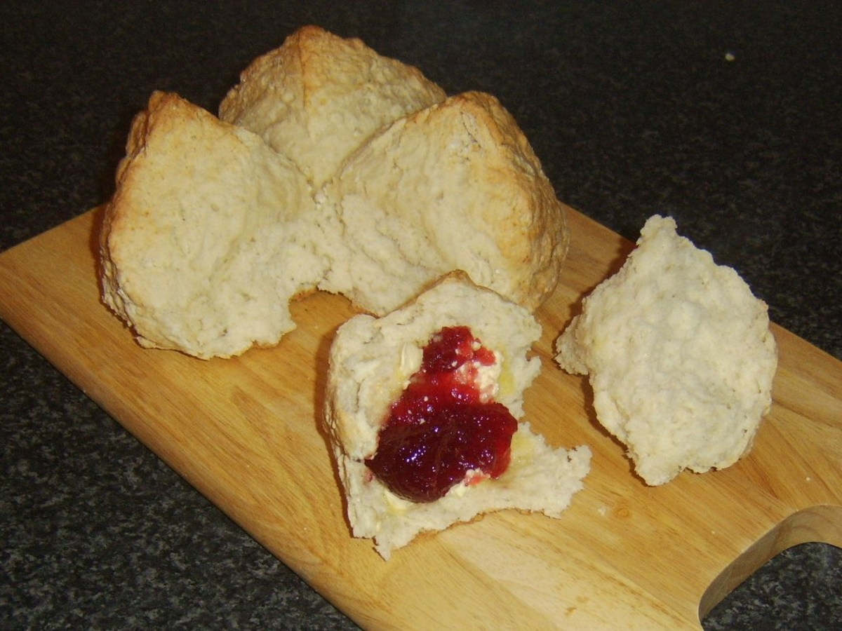 Freshly made, still warm soda bread with butter and jam.